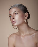 Portrait of Gorgeous Woman with Earrings Royalty Free Stock Photo