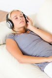 Portrait of a gorgeous woman listening to music stock images