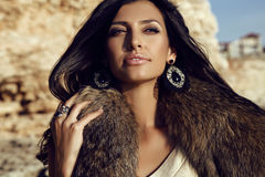 Portrait of gorgeous woman with long dark hair wears fur Royalty Free Stock Images