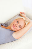 Portrait of gorgeous woman lying on a sofa Stock Images