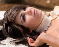 Lying in the Sunlight. A portrait of a gorgeous woman reclining outside Stock Image