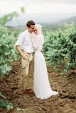 Portrait of a gorgeous women and man in the vineyards royalty free stock photography
