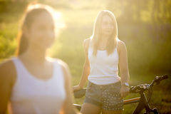 Portrait of gorgeous young blond woman with bike royalty free stock images
