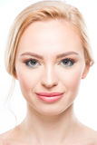 Portrait of gorgeous young blonde woman smiling at camera, skincare concept Royalty Free Stock Image