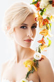 Portrait of a gorgeous, young bride with flowers. Portrait of gorgeous, young bride in a white dress posing with flowers Stock Images