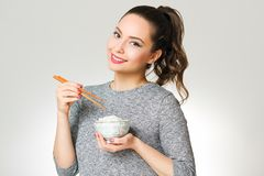Cute brunette eating asian food. Stock Photography