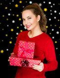 Brunette woman holding Christmas gifts. Royalty Free Stock Image