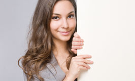 Young businesswoman with large blank banner. Stock Image