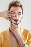 Portrait of gorgeous young gay with makeup and healthy skin Royalty Free Stock Photography