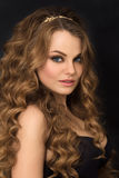 Portrait of gorgeous young woman with long curly hair Royalty Free Stock Photography