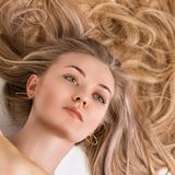 Portrait of a gorgeous young woman with luxurious blonde hair. Photo from above royalty free stock photo