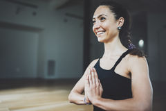 Portrait of gorgeous young woman practicing yoga indoor. Beautiful girl practice meditation asana in class.Calmness and Royalty Free Stock Images