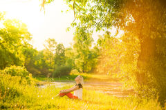 Portrait of gorgeous young woman in sunlight outside Royalty Free Stock Photos