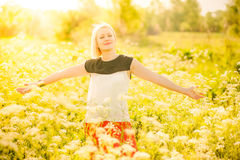 Portrait of gorgeous young woman in sunlight outside Royalty Free Stock Photography