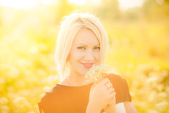Portrait of gorgeous young woman in sunlight outside Royalty Free Stock Images