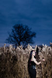 Portrait of the gothic woman in a high, dry grass Royalty Free Stock Image
