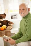 Portrait of grandfather in baby room. Stock Photo