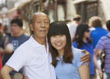 Portrait of grandfather and granddaughter together, outdoors in Beijing Royalty Free Stock Photos