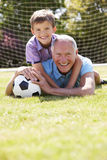 Portrait Of Grandfather And Grandson With Football Royalty Free Stock Photo