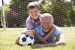 Portrait Of Grandfather And Grandson With Football Royalty Free Stock Photos