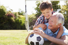 Portrait Of Grandfather And Grandson With Football Stock Images
