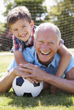 Portrait Of Grandfather And Grandson With Football Royalty Free Stock Image