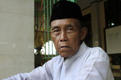 Portrait of grandfather from Indonesia stock image
