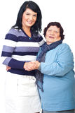 Portrait of grandma with granddaughter. Portrait of happy grandma with her granddaughter holding hands isolated on white background,check also Grandmother Stock Images