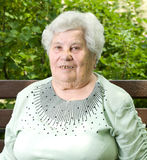 Portrait of a grandmother. Grandmother is resting in a park Stock Photos