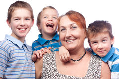 Portrait of a grandmother and four grandchildren Stock Photos