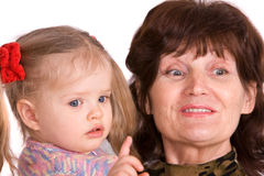 Portrait of grandmother and granddaughter. Royalty Free Stock Photos