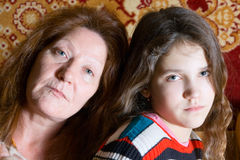 Portrait of grandmother and granddaughter. Portrait of family grandmother and granddaughter Royalty Free Stock Image