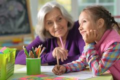 Portrait of grandmother and granddaughter drawing Royalty Free Stock Image