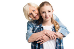 Portrait of grandmother and granddaughter embracing Stock Image