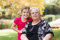 Portrait of a grandmother and granddaughter in the garden. Stock Photos