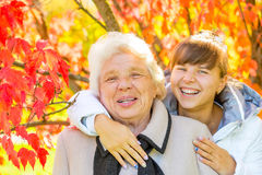 Portrait of grandmother and granddaughter. Happy portrait of grandmother and granddaughter Stock Images