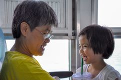 Portrait of grandmother and granddaughter looking at and playing each other during traveling royalty free stock photos