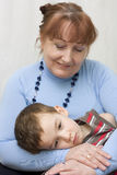 Portrait of grandmother with a grandson. Royalty Free Stock Images