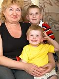 Portrait of the grandmother with the grandsons Royalty Free Stock Images