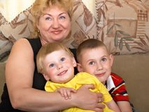 Portrait of the grandmother with the grandsons Royalty Free Stock Photos