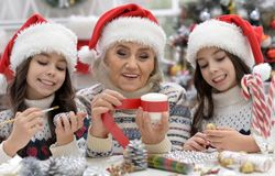 Portrait of grandmother with girls preparing for Christmas royalty free stock images
