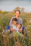 Portrait of   grandmother and two granddaughters. Beautiful grandmother with two granddaughters walking in  summer field royalty free stock images
