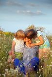 Happy grandmother with two granddaughters. Portrait of   grandmother and two granddaughters of 4 and 6 years old stock photography