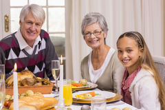 Portrait of grandparents and daughter during christmas dinner Stock Photo