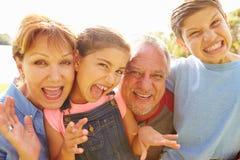 Portrait Of Grandparents And Grandchildren In Garden Stock Photography