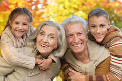 Portrait of grandparents with grandchildren. Posing outdoors in autumn royalty free stock images