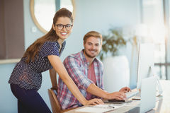 Portrait of graphic designers working on personal computer. In office Royalty Free Stock Image