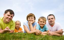 Portrait great families with their children. Portrait of a cheerful great families with their children outdoor. Seven royalty free stock image