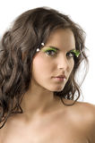 Portrait in green. Portrait of a young and cute woman with artificial green eyelashes royalty free stock photo