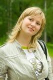 Portrait of green-eyed girl. Nice green-eyed girl walking in park Stock Images